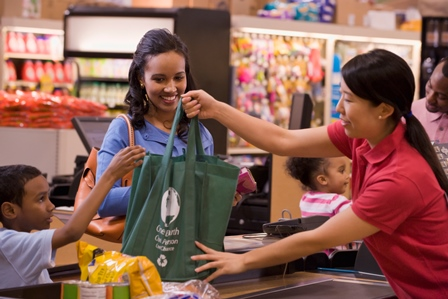 Family shopping with reusable bags