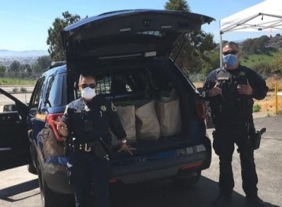 DSAL Officers help with food giveaway